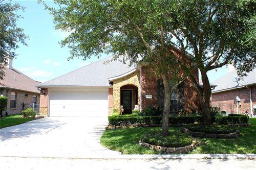 Photo of 22124 Lancelot Oaks Drive, Kingwood, TX 77339 (MLS # 76437003)