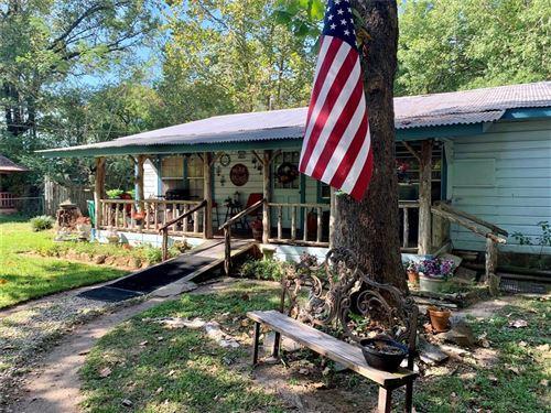 Photo of 216 S Magnolia Drive, Conroe, TX 77301 (MLS # 70525006)