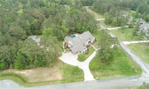 Photo of 29512 Timber Village Ct, Magnolia, TX 77355 (MLS # 97221015)