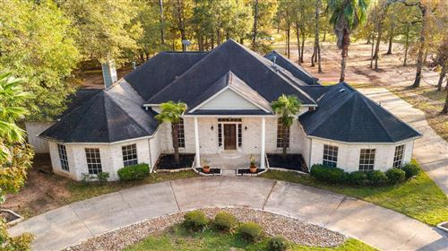 Photo of 10848 Lake Forest Drive, Conroe, TX 77384 (MLS # 36194017)