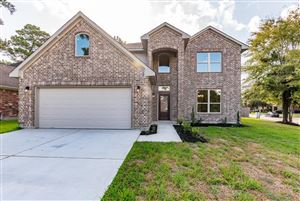 Photo of 8502 Joggers Lane, Humble, TX 77346 (MLS # 39871024)