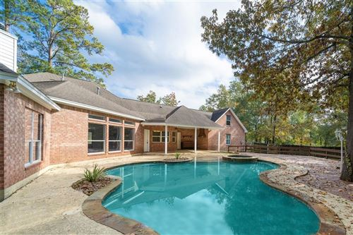 Photo of 717 Mountain View Drive, Montgomery, TX 77356 (MLS # 65592035)