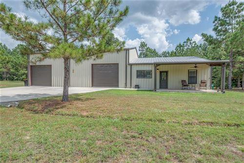 Photo of 12906 S Lee, Conroe, TX 77303 (MLS # 14861047)