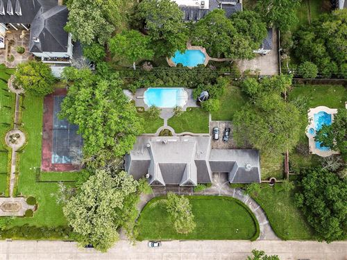 Photo of 11015 N Country Squire Street, Houston, TX 77024 (MLS # 27966112)