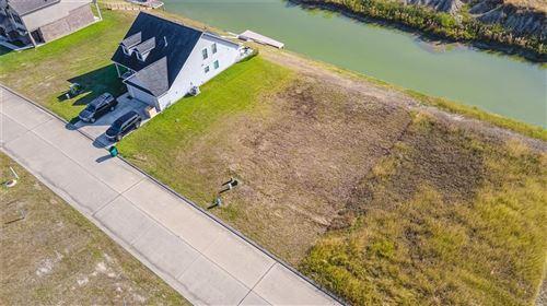 Photo of 10741 S Lake Mist Lane, Willis, TX 77318 (MLS # 8672121)