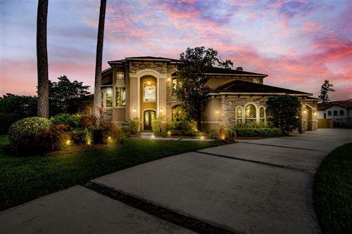 Photo of 39 Oak Cove Lane, Kingwood, TX 77346 (MLS # 58005166)