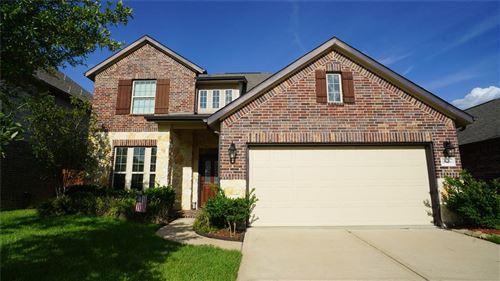 Photo of 10506 Hartfield Bluff Lane, Cypress, TX 77433 (MLS # 40746195)