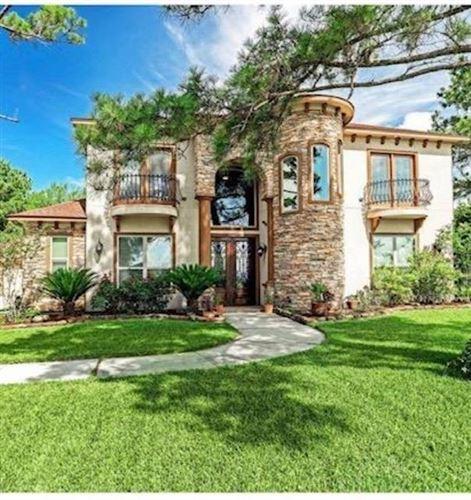 Photo of 10881 Dauphine Street, Willis, TX 77318 (MLS # 24193207)
