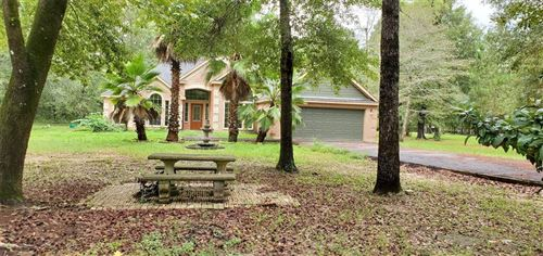 Photo of 7634 Timber Switch Road, Cleveland, TX 77328 (MLS # 28769207)