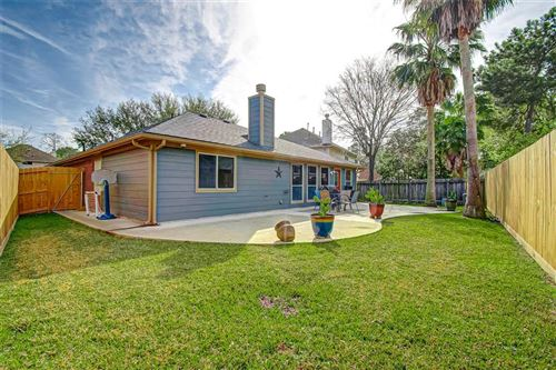 Photo of 16315 Mossy Grove Dr, Humble, TX 77346 (MLS # 54559251)