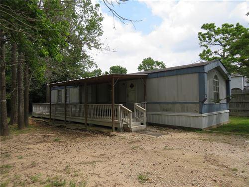 Photo of 418 W Powell, Willis, TX 77378 (MLS # 74758255)