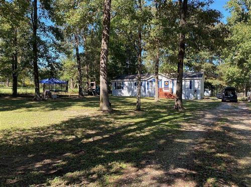 Photo of 13246 Tom Sawyer Street, Willis, TX 77318 (MLS # 47319259)
