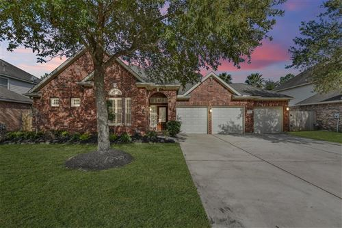 Photo of 14414 Wildwood Springs Lane, Houston, TX 77044 (MLS # 80059263)