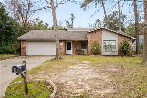Photo of 1707 Surry Oaks Drive, New Caney, TX 77357 (MLS # 24760358)