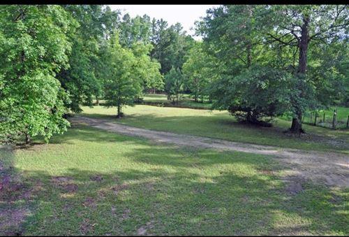 Photo of 7906 Hodge Lane, Montgomery, TX 77356 (MLS # 54576360)