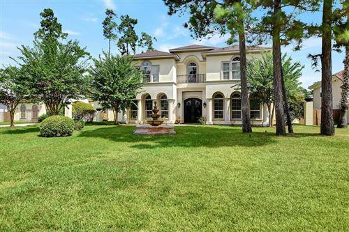 Photo of 38 Oak Cove Lane, Kingwood, TX 77346 (MLS # 81013374)