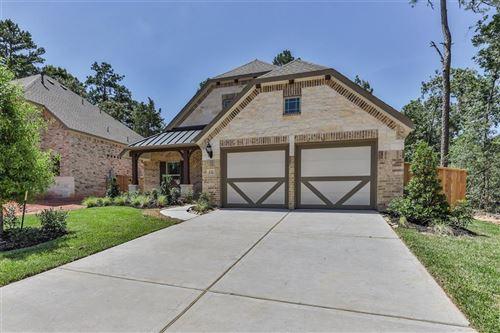 Photo of 132 N Cadence Hills Loop, Willis, TX 77318 (MLS # 36589375)