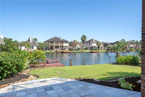 Photo of 10122 Lazy Lagoon, Houston, TX 77065 (MLS # 61236384)