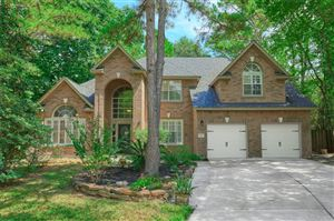 Photo of 11 Harvest Green Place, The Woodlands, TX 77382 (MLS # 13854422)