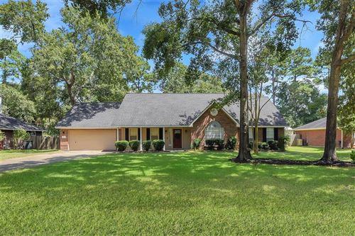 Photo of 423 E Oak Hill Drive, Oak Ridge North, TX 77386 (MLS # 42643468)