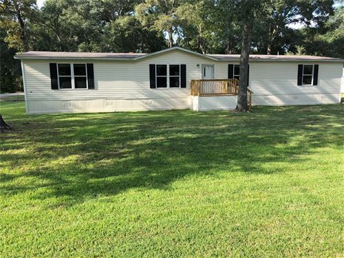 Photo of 15385 Lilly Dr, Conroe, TX 77384 (MLS # 90293501)