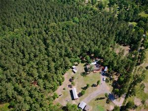 Photo of 660 Hopkins Road, Oakhurst, TX 77359 (MLS # 24171531)
