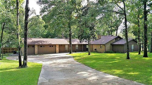 Photo of 40 Yaupon Court, Panorama Village, TX 77304 (MLS # 21428568)