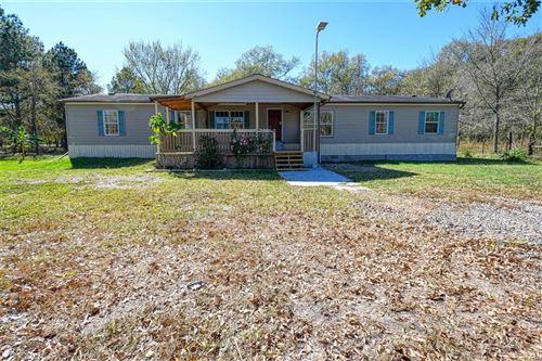 Photo of 11954 Churchhill Downs, Montgomery, TX 77316 (MLS # 26023597)