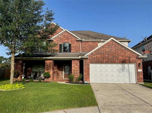 Photo of 26124 Queens Glen Drive, Kingwood, TX 77339 (MLS # 37118607)