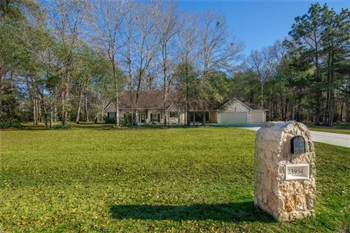 Photo of 23954 Mossy Oaks Drive Drive, New Caney, TX 77357 (MLS # 93044611)