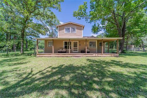 Photo of 10033 Bilnoski Road, Willis, TX 77378 (MLS # 26150677)