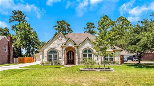Photo of 511 E Oak Hill Drive, Oak Ridge North, TX 77386 (MLS # 96417701)