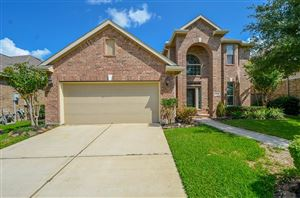 Photo of 19114 Cove Forest Lane, Cypress, TX 77433 (MLS # 89484709)
