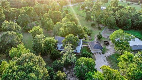 Photo of 5295 Woodland Lakes Drive, Willis, TX 77378 (MLS # 83227769)