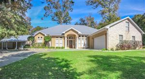 Photo of 671 Villagebrook, Livingston, TX 77351 (MLS # 33677810)