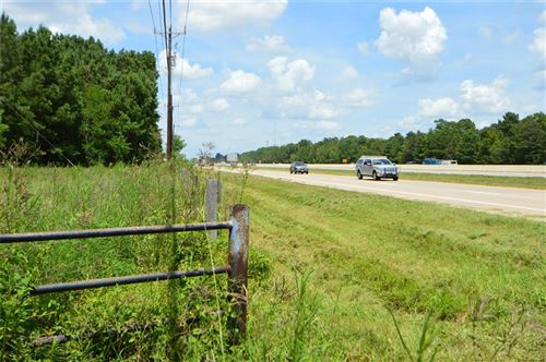 Photo of 18286 Hwy 59, New Caney, TX 77357 (MLS # 42831844)