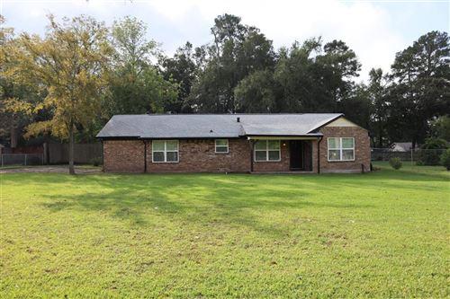Photo of 205 Woodland Drive, Conroe, TX 77301 (MLS # 69633844)