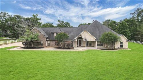 Photo of 31011 Edgewater Drive, Magnolia, TX 77354 (MLS # 70578848)