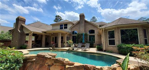 Photo of 30 E Majestic Woods Place, The Woodlands, TX 77382 (MLS # 10481871)