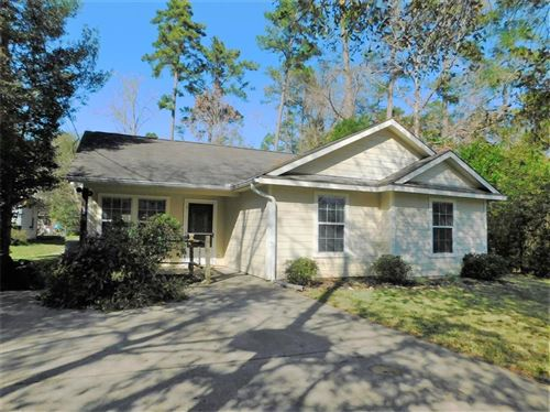 Photo of 10671 Royal Forest Drive, Conroe, TX 77303 (MLS # 47311886)