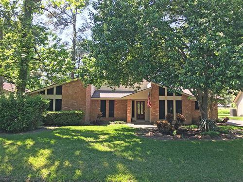 Photo of 1707 Chestnut Ridge Road, Kingwood, TX 77339 (MLS # 97935906)