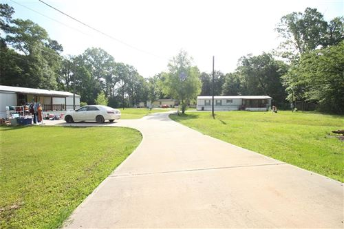 Photo of 112 County Road 3563, New Caney, TX 77357 (MLS # 10877911)