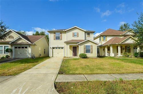 Photo of 12039 Madison Oak Street, Houston, TX 77038 (MLS # 64977975)
