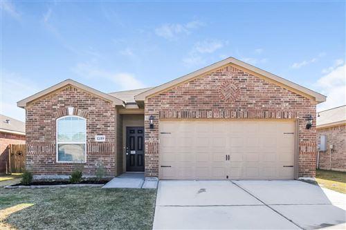 Photo of 12019 Fairquarter Lane, Pinehurst, TX 77362 (MLS # 38259977)