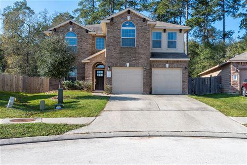 Photo of 11530 W Woodmark, Conroe, TX 77304 (MLS # 94119980)