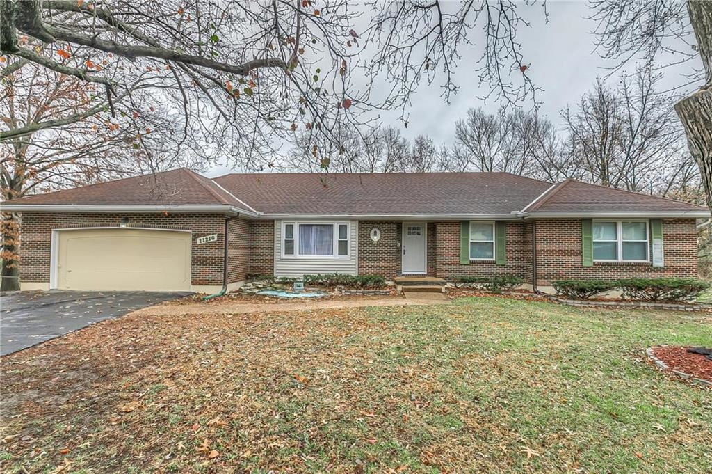 Photo of 11216 E 64th Street, Raytown, MO 64133 (MLS # 2254093)