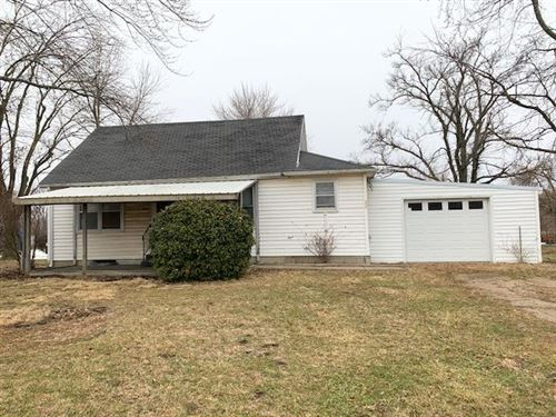 Photo of 606 E 10th Street, Holden, MO 64040 (MLS # 2206637)