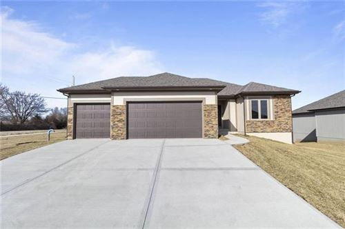 Photo of 910 NW Hickorywood Court, Grain Valley, MO 64029 (MLS # 2350799)