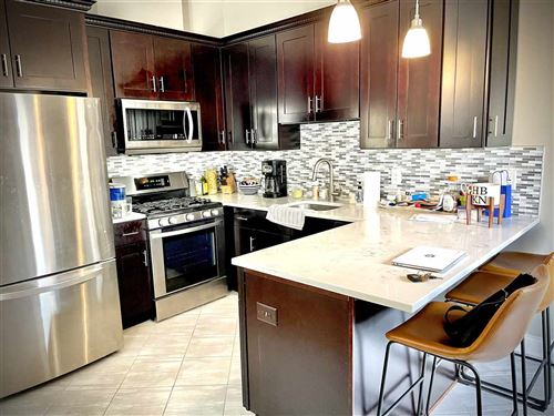Photo of 247 CAMBRIDGE AVE #3, Jersey City, NJ 07307 (MLS # 210010634)