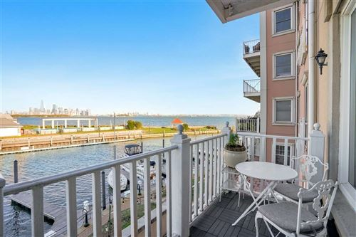 Photo of 109 SHEARWATER CT EAST #21, Jersey City, NJ 07305 (MLS # 202023637)